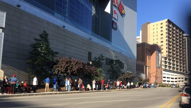 Fans in line for tickets for Friday's Muhammad Ali service are wrapped around the back of the KFC Yum! Center.