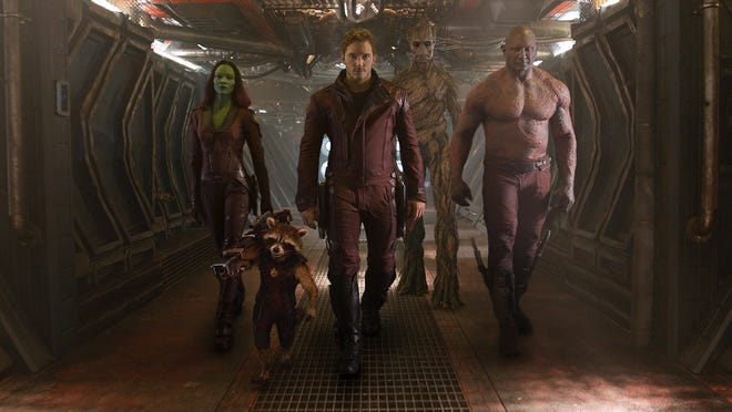 """Gamora (Zoe Saldana), Rocket Racoon (voiced by Bradley Cooper), Peter Quill (Chris Pratt), Groot (voiced by Vin Diesel) and Drax the Destroyer (Dave Bautista) are on a mission to save the universe in """"Guardians of the Galaxy."""""""