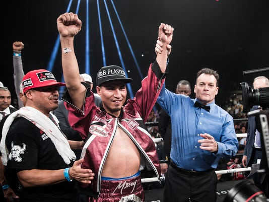 Mikey Garcia wins title