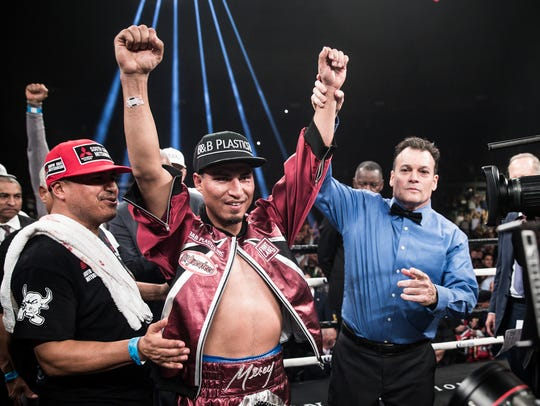 Mikey Garcia celebrates after winning a title in his fourth weight class earlier this year beating Sergey Lipinets.