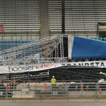 A flag flies at half-staff during the investigation into the State Fair stage collapse at the Indiana State Fairgrounds Tuesday, Sept. 7, 2011.