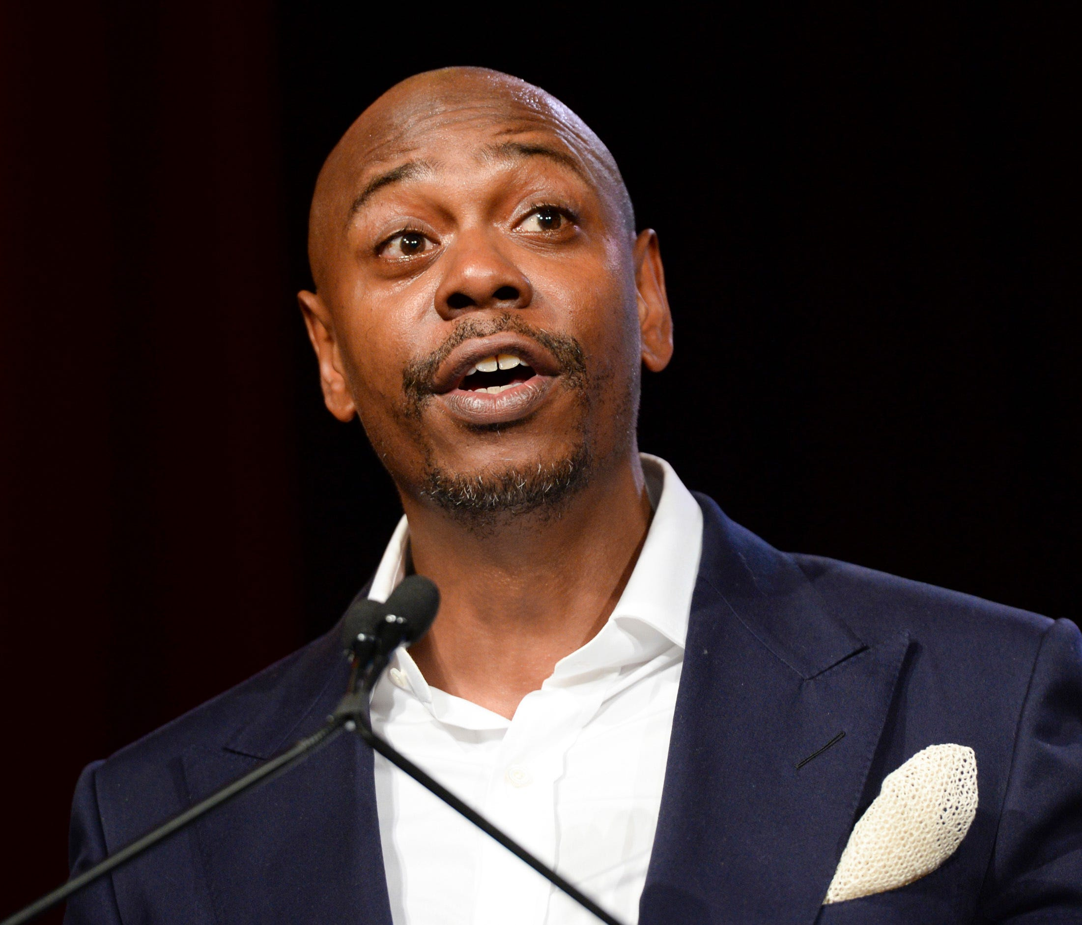 FILE - In this July 18, 2015 file photo, comedian Dave Chappelle speaks at the RUSH Philanthropic Arts Foundation's Art for Life Benefit in New York. Chappelle is urging progressive policing in his southwestern Ohio hometown, where questions have bee