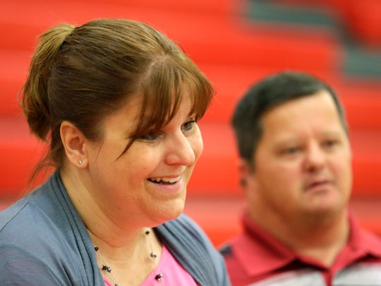 "Special education teacher Amy Reed and her brother Tim Bird after she was named the Wisconsin Special Services Teacher of The Year during a ceremony at Kimberly High School on Thursday, September 3, 2015, in Kimberly, Wis. Reed says the her brother is her ""inspiration.""