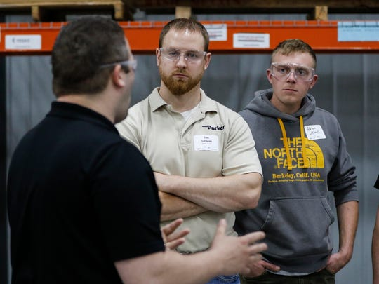 Eric Lipinsky and Adrian LeClair listen to Kelly Reif during the Chamber Young Professional's tour of Orion Energy Tuesday, Apr. 25, 2017, in Manitowoc, Wis. Josh Clark/USA TODAY NETWORK-Wisconsin