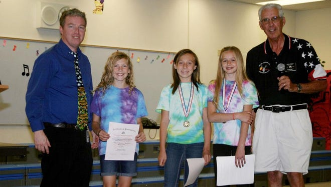 JLBES Principal Christopher Jenkins stands with students Jayme Hulet, Hannah Linge, Jerusha Bundy and Larry Knievel, Elks Americanism chair after the awards ceremony.