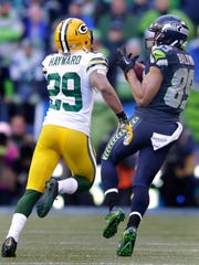 Seattle Seahawks receiver Doug Baldwin catches a first-down pass against Green Bay Packers cornerback Casey Hayward during overtime of Sunday's NFC championship game at CenturyLink Field in Seattle.