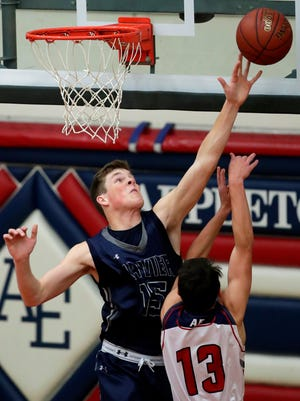 Xavier High School's Nate DeYoung blocks a shot from Appleton East High School's Nathan Lemons during the 2017 Big Apple Classic, Nov. 22, 2017, Appleton.