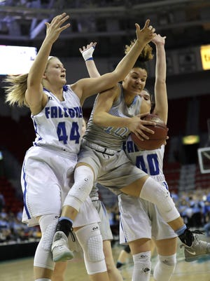 Amherst High School's Heather Pearson, left, and Lauren Boelte, right, defend against Saint Thomas More High School's Kya Gordon during their Division 3 semifinal game at the WIAA state girls basketball tournament Thursday, March 8, 2018, at the Resch Center in Ashwaubenon, Wis.  Dan Powers/USA TODAY NETWORK-Wisconsin