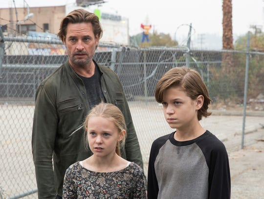 "Josh Holloway stars as dad Will Bowman to Isabella Crovetti-Cramp's Grace and Jacob Buster's Charlie in the USA series ""Colony."""