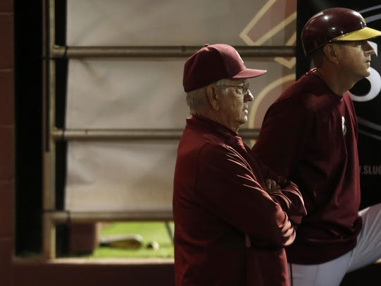 FSU Head Coach Mike Martin and Assistant Coach Mike Martin Jr. watch their team take on St. John's at Dick Howser Stadium on March 4, 2016.