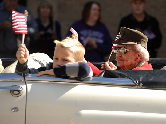 Parade grand marshall Ellen Webb and her great-grandson, Sam Elliott, 6, ride the parade route during the Veterans Day parade Nov. 12, 2016, in downtown Abilene.