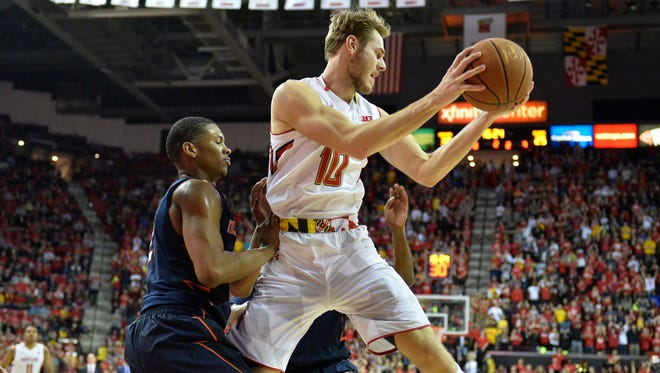 Mar 3, 2016; College Park, MD, USA; Maryland Terrapins forward Jake Layman (10) rebounds in front pf Illinois Fighting Illini guard Malcolm Hill (21) during the second half at Xfinity Center. Maryland Terrapins defeated Illinois Fighting Illini 81-55.