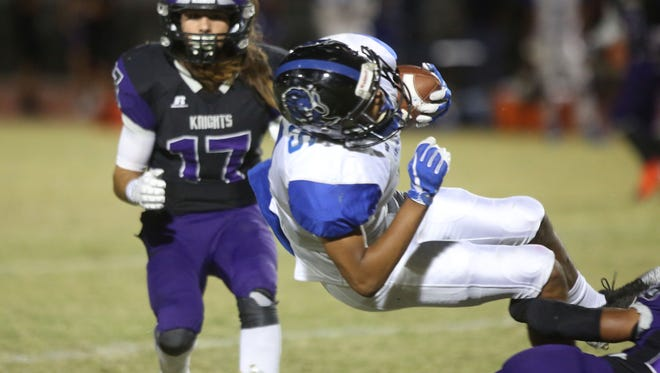 Cathedral City runner Timothy Miller Jr. is upended against Shadow Hills, September 21, 2017.