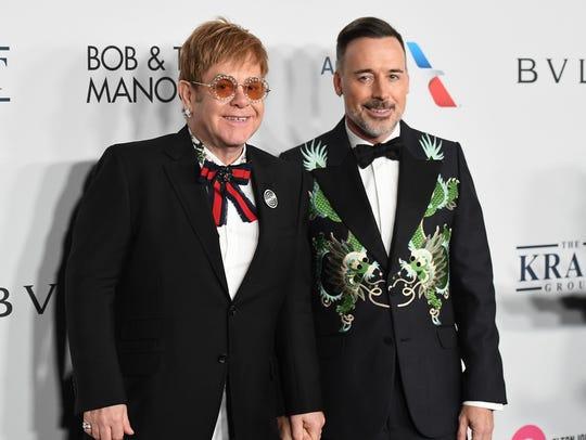 Elton John, left, and his husband, producer David Furnish,