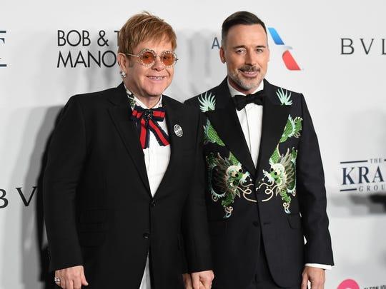 Elton John, left, and his husband, producer David Furnish, celebrated the 25th year of the Elton John AIDS Foundation  in New York on Nov. 7, 2017.