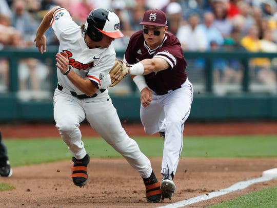 Mississippi State third baseman Justin Foscue (17) tags out Oregon State Beavers shortstop Cadyn Grenier (2) in the first inning of last year's College World Series game TD Ameritrade Park. Mandatory Credit: Bruce Thorson-USA TODAY Sports