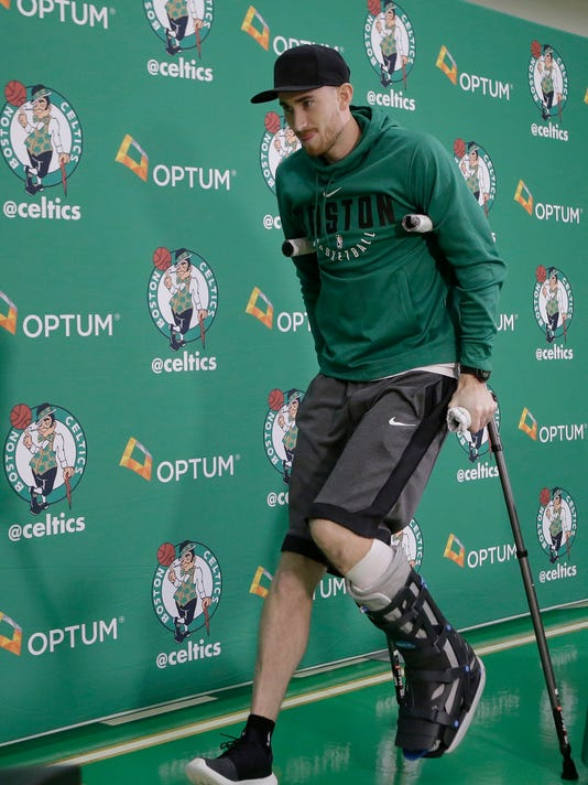 Boston Celtics' Gordon Hayward uses crutches as he steps away from a podium after taking questions from members of the media at an NBA basketball news conference, Thursday, Nov. 2, 2017, at the team's' training facility in Waltham, Mass. Hayward, who broke his ankle about 5 minutes into his NBA career opener at Cleveland on Oct. 17, says he knows he will not play again this season, after needing surgery to repair the injury. (AP Photo/Steven Senne)