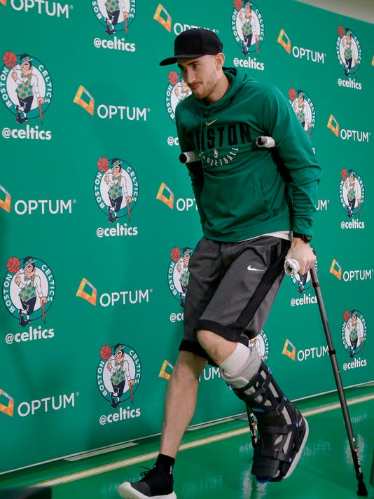 FILE - In this Nov. 2, 2017, file photo, Boston Celtics' Gordon Hayward uses crutches as he steps away from a podium after taking questions from members of the media at an NBA basketball news conference, in Waltham, Mass.  The Celtics have had to overcome their share of adversity this season, battling injuries after an offseason overhaul that began with so much expectation. Offseason acquisitions Kyrie Irving and Gordon Hayward have both suffered season-ending injuries. Yet somehow Boston enters the playoffs as the No. 2 in the Eastern Conference with a legitimate chance to win the conference. (AP Photo/Steven Senne, File)