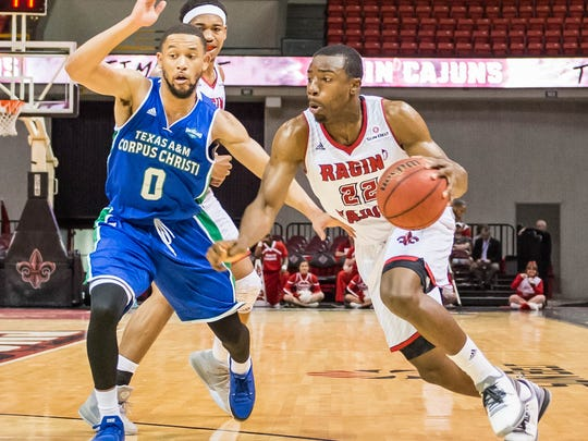 UL's Johnathan Stove (22) makes a move to the basket during the Cajuns' CIT win over Texas A&M-Corpus Christi.