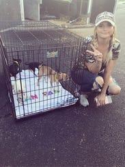 Miranda Lambert poses with dogs she and her MuttNation