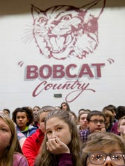 Alex Healy, 13, center, and her Mount Vernon Junior High School classmates listen to Posey County Sheriff Greg Oeth during an assembly, iBuckleUP weBuckleUP, at the school Friday afternoon.