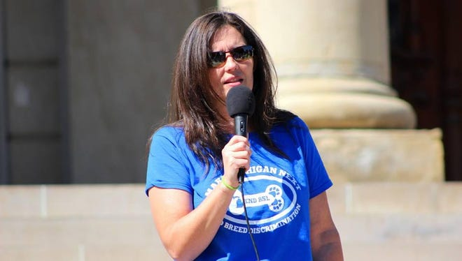 Courtney Protz-Sanders of MI-PACA emcees a rally in Lansing to end dog breed discrimination.