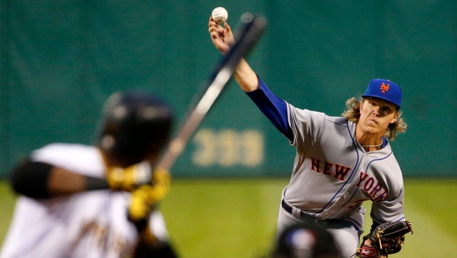 New York Mets starting pitcher Noah Syndergaard delivers to Pittsburgh Pirates' Starling Marte in the sixth inning of a baseball game in Pittsburgh, Friday, May 22, 2015.