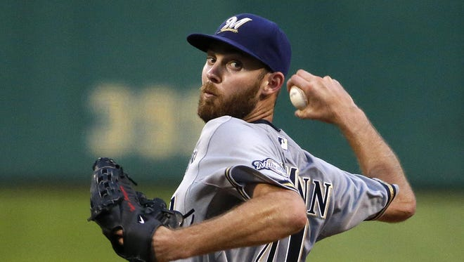 Milwaukee Brewers starting pitcher Taylor Jungmann (41) delivers in the seventh inning of his first major league start against the Pittsburgh Pirates.