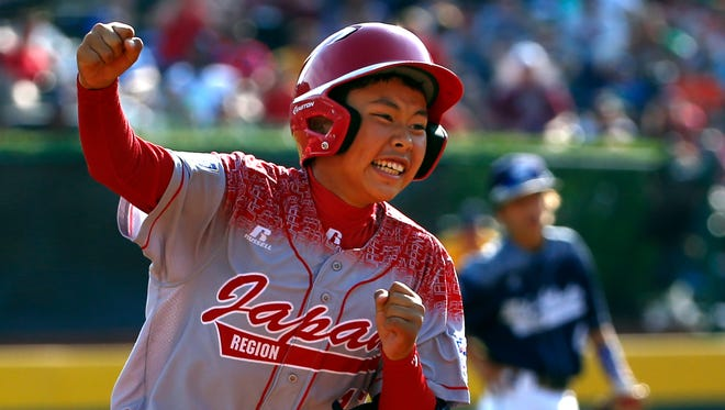 Japan's Masafuji Nishijima, left, rounds third after hitting a three-run home run off Lewisberry, Pa.'s Jaden Henline in the third inning of the Little League World Series Championship baseball game in South Williamsport, Pa., Sunday, Aug. 30, 2015.