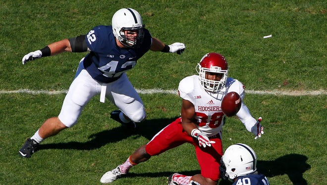 Penn State linebacker Troy Reeder (left) closes on Indiana receiver Damon Graham during a game in October, 2015.