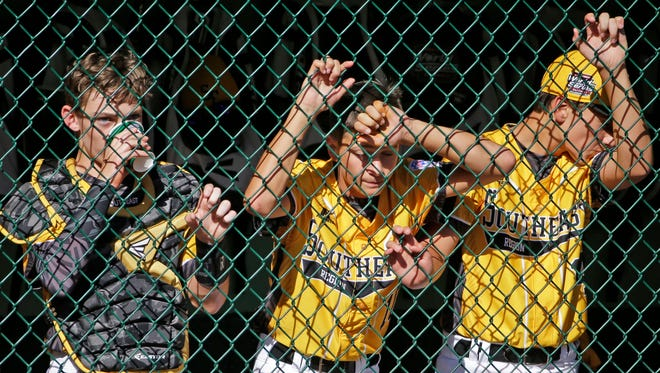 Members of the Goodlettsville team stand in the dugout during the sixth inning of a baseball game against Endwell, New York in United States pool play at the Little League World Series tournament in South Williamsport, Pa., Monday, Aug. 22, 2016. New York won 3-1.(