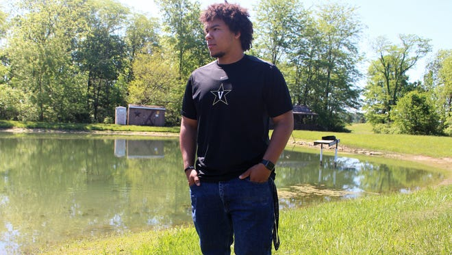 Franklyn Lofton, a recent graduate of Ridgedale, stands next to his family pond. He helped his grandfather build a small windmill there when he was just 4-years-old. Now, the 18-year-old will be attending Vanderbilt University for engineering this fall.