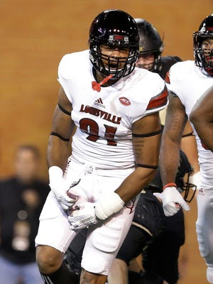 Louisville's Trevon Young (91) reacts after a sack against Wake Forest in the first half of an NCAA college football game in Winston-Salem, N.C., Friday, Oct. 30, 2015. (AP Photo/Chuck Burton)