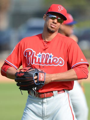 Phillies outfielder Aaron Altherr warms up at the start of the workout Feb. 29 at Bright House Field.