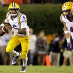LSU Tigers quarterback Brandon Harris (6) looks for a receiver during a game at Auburn last season.