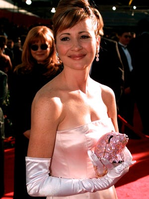 """In this March 25, 1996 file photo, Christine Cavanaugh arrives for the 68th Academy Awards at the Music Center in Los Angeles. Cavanaugh, 51, a prolific voice actress whose characters included the titular character of """"Babe,"""" has died. Cavanaugh's sister Deionn Masock confirmed Tuesday, Dec. 30, 2014, that Cavanaugh died December 22 at her home in Utah."""