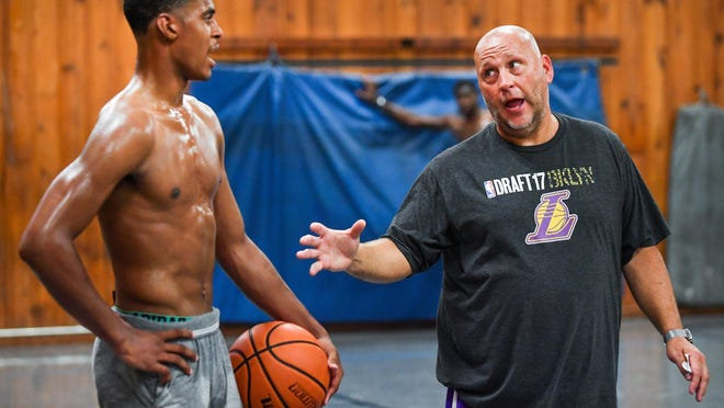 Incoming Illinois freshman Adam Miller works with David Williams at the Hanna City Park District gymnasium in 2018. Miller began working out with Williams and Illini teammate Da'Monte Williams at that gym in middle school.