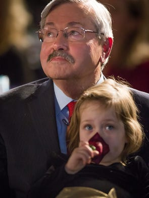 Gov. Terry Branstad receives the company of his granddaughter