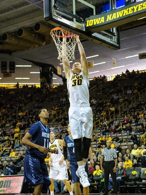 Iowa's Aaron White (30) dunks against Northwood during