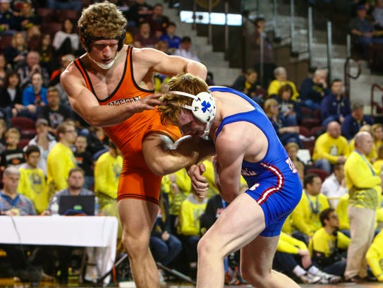 Catholic Central's Rory Cox (right) won his 160-pound