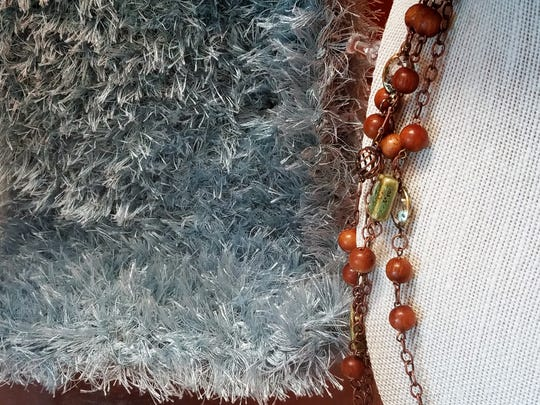 It could be a gift or part of your favorite new fall or winter outfit. Many wearables such as this fuzzy scarf or pretty hand-beaded necklace are available at the Friends of the Ohio Township Public Library silent auction.