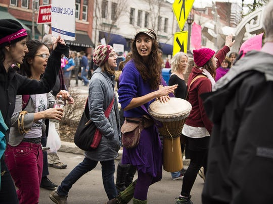 Marchers chant and sing while rounding Pritchard Park Saturday afternoon during the Women's March on Asheville, one of the hundreds of similar marches happening around the world to march for equal rights, just one day after President Donald Trump.