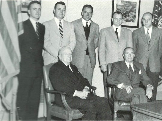 """In this undated photo, John """"Jack"""" Worrilow (standing far left), stands behind his father, William H. Worrilow (seated left) and Thomas S. Quinn (seated right), co-owners of the Lebanon Foundry, after being hired to work at the foundry after serving in World War II, along with (standing left to right) William H. Worrilow Jr., Thomas S. Quinn Jr., Harry L. Quinn and John M. Quinn"""