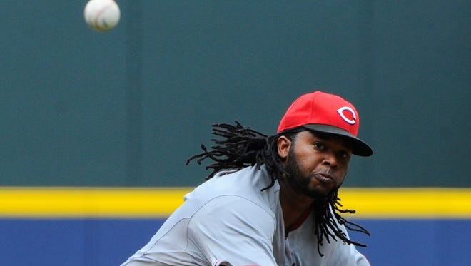 Reds starting pitcher Johnny Cueto pitches during the first inning Sunday at Turner Field.