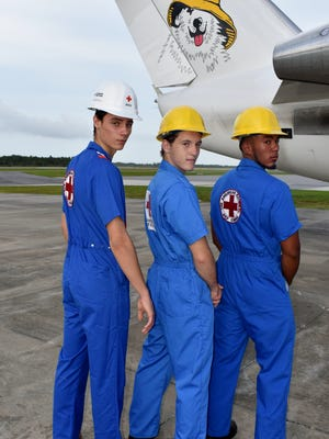 Michael Campion, Gerald McFarland and Pedro Tellez model vintage American Red Cross jumpsuits.