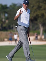 Pro Matt Kuchar waves to the crowd after sinking a putt on No. 8 during the first round of the Franklin Templeton Shootout at Tibur—n Golf Club at The Ritz-Carlton Golf Resort Thursday, Dec. 8, 2016 in Naples. Kuchar and teammate Harris English would finish the day in second place with a score of 15-under par.