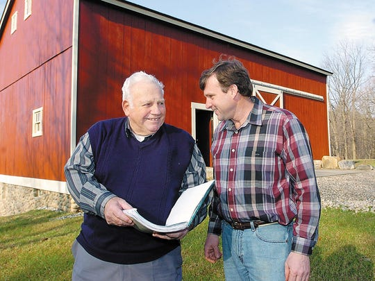 Both Marv Gans (left) and Ken Brock have put many hours into restoring this circa-1850s barn now located at Thayer's Corner Nature Area. They, along with Dan Schneider, not pictured, were recently honored by the Michigan Barn Preservation Organization with an award for their efforts in re-building and updating the barn.