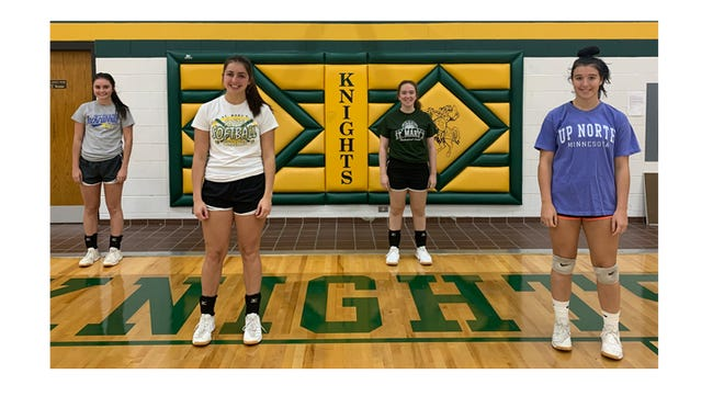 Seniors on the Knights volleyball team, from left: Sydney Windschitl, Emily Weiss, Leah Miller,  and Trista Ibberson.
