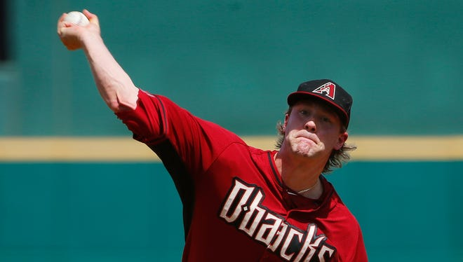 Arizona Diamondbacks starter Archie Bradley throws a pitch against the Cincinnati Reds during the first inning of a Cactus League game on Wednesday, April 1, 2015, in Goodyear.