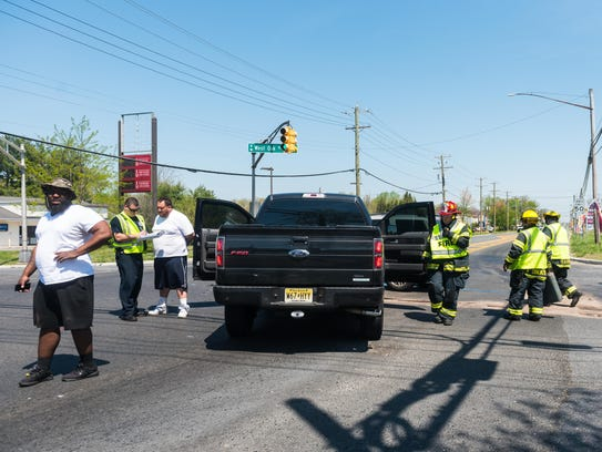 Vineland firefighters clean up after a two car accident